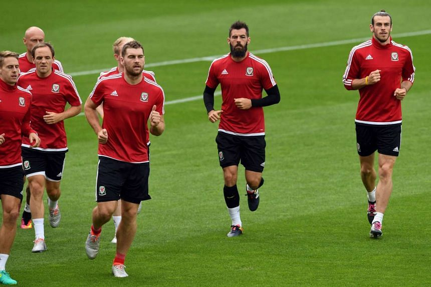 Wales' players warm up during a training session at the Bollaert stadium in Lens, on June 15, on the eve of the Euro 2016 group B football match England vs Wales.
