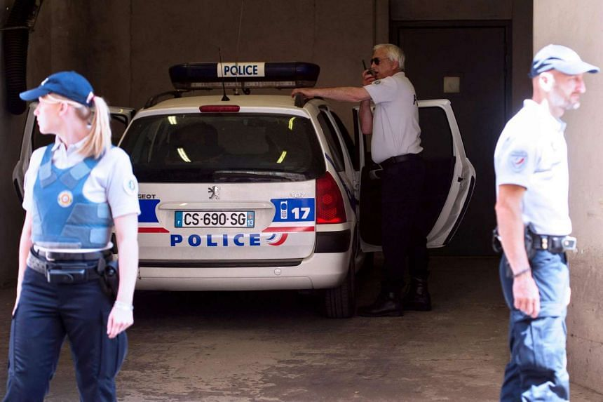 A suspected Russian hooligan arrives with policemen on June 13, 2016, at the courthouse of Marseille.