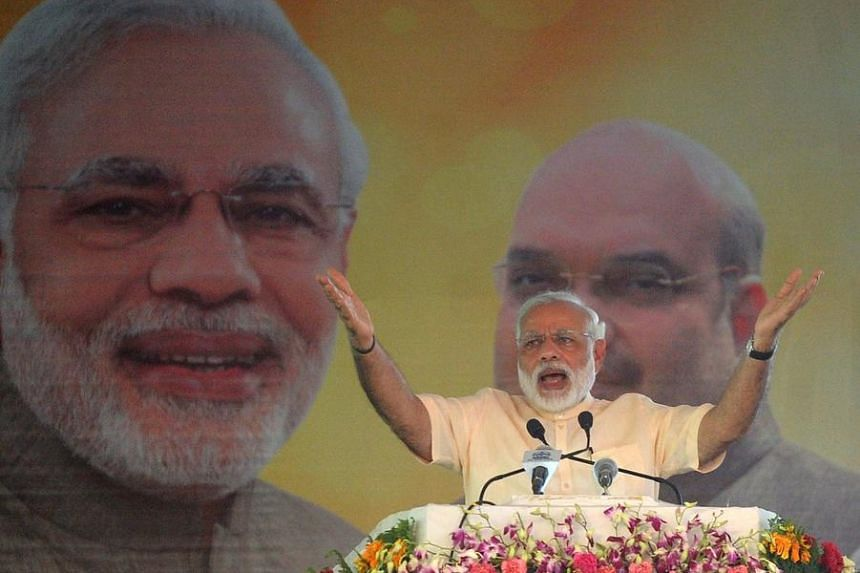 Indian Prime Minister Narendra Modi gestures as he addresses a Parivartan Rally in Allahabad, on June 13, 2016.