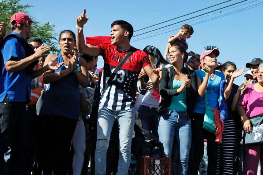 People protest for the lack of food, in San Cristobal, Tachira state, in the border with Colombia on June 16, 2016.