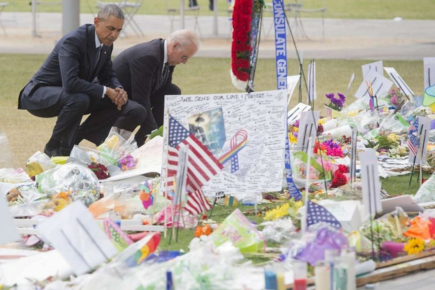 US President Barack Obama and Vice-President Joe Biden at a memorial for the victims of the mass shooting at Pulse nightclub at the Dr. Phillips Center for the Performing Arts in Orlando on June 16, 2016.