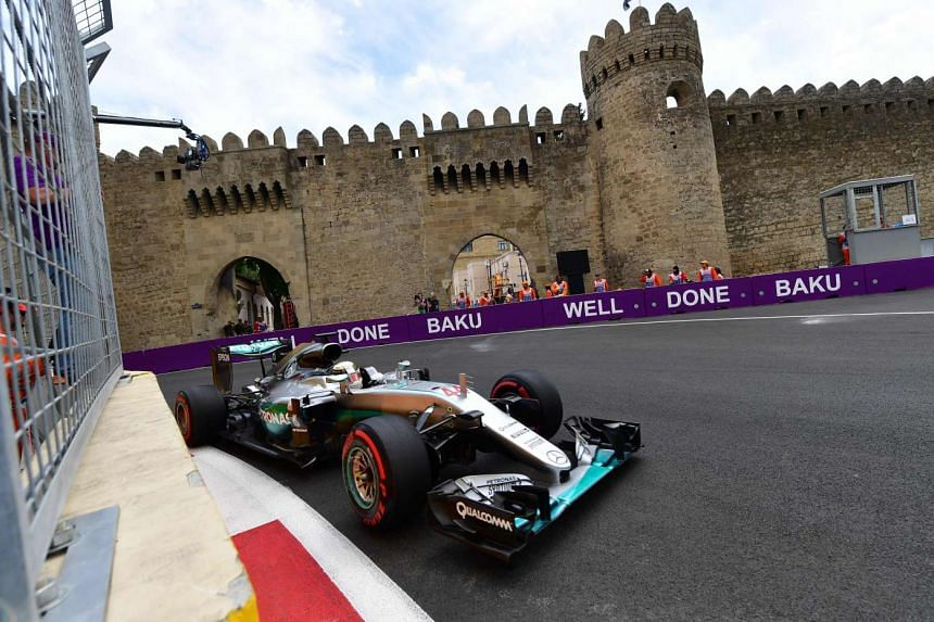 Mercedes AMG Petronas F1 Team's British driver Lewis Hamilton steers his car at the Baku City Circuit, on June 17, 2016 in Baku, during the first practice session for the European Formula One Grand Prix.