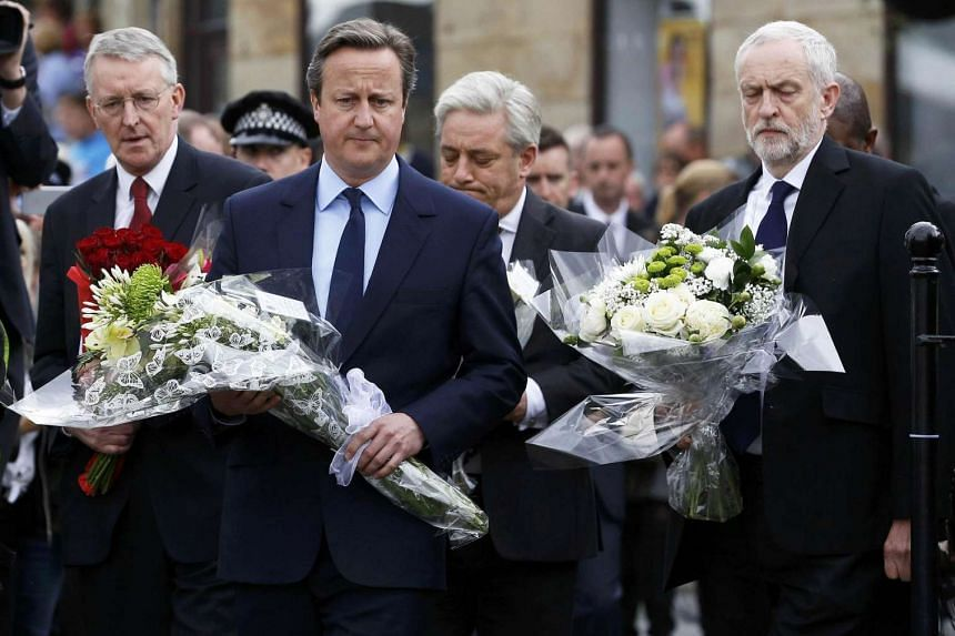 Britain's Prime Minister David Cameron (centre), Labour Party leader Jeremy Corbyn (right), and Labour MP Hilary Benn arrive to pay tribute to Labour MP Jo Cox in Birstall, on June 17, 2016.