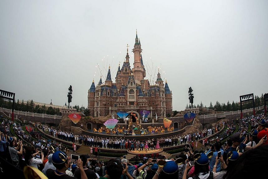 More than 30 dancers and flag twirlers frolicked as performers dressed as Disney princesses took to the stage at the opening ceremony of Shanghai Disney Resort yesterday.