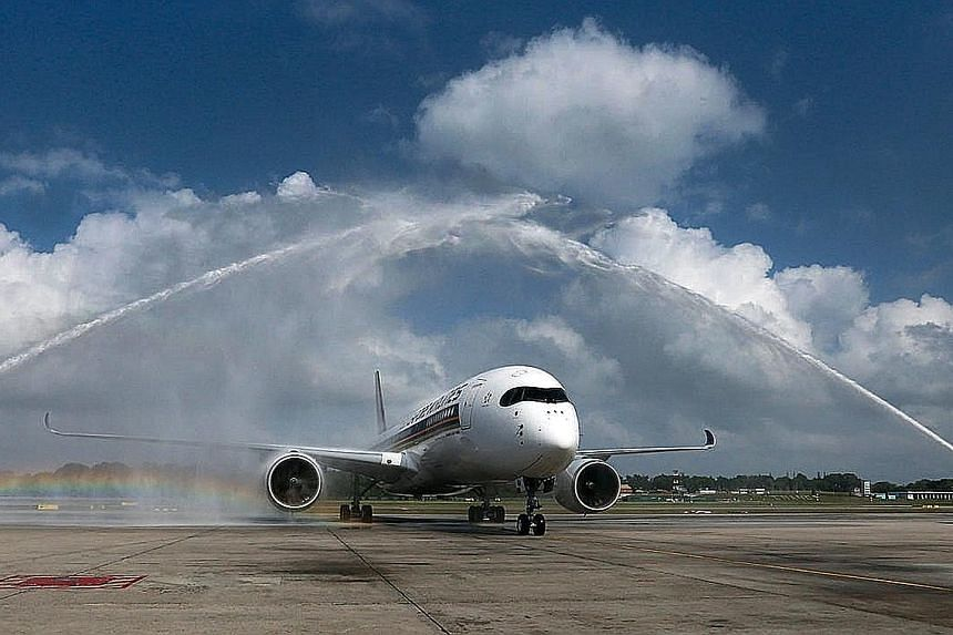 Two fire engines giving the first of 67 Airbus 350s a water-cannon salute on its arrival at Changi Airport's Terminal 3 on March 3. The new SIA flights to San Francisco will use A350-900 aircraft.