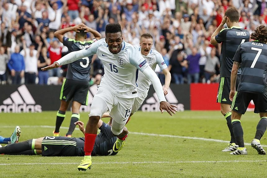 England striker Daniel Sturridge celebrating after scoring his team's winning goal in stoppage time for a dramatic 2-1 victory over Wales at Euro 2016 yesterday. Despite trailing at half-time, England were able to recover. Outside the match venues, t