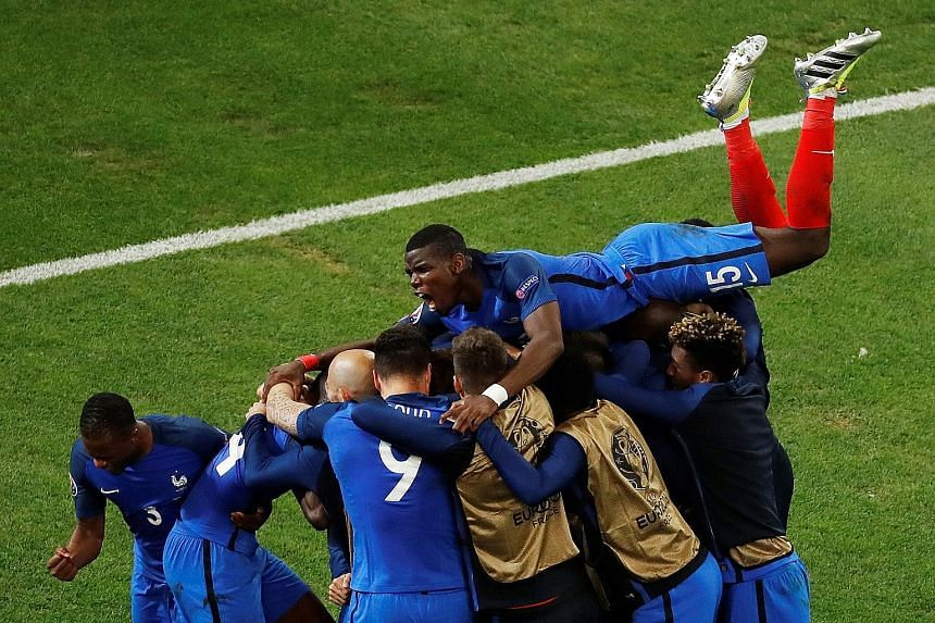 The French team celebrating substitute Antoine Griezmann's 90th-minute goal, which finally broke Albania's resistance. France regulars Paul Pogba and Antoine Griezmann both started on the bench against Albania.