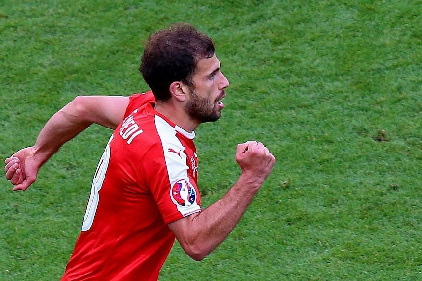 Admir Mehmedi's equaliser against Romania put the Swiss on the brink of reaching the European Championship's knockout stages for the first time.