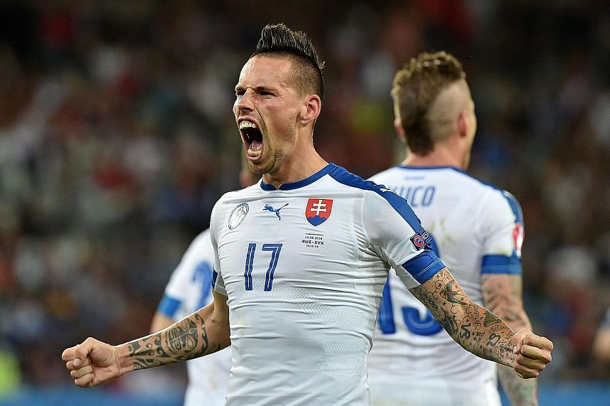 "Slovakia midfielder Marek Hamsik celebrating his goal against Russia. His national team coach Jan Kozak has tipped his star man to move on from Serie A side Napoli, who have become ""too small for him""."