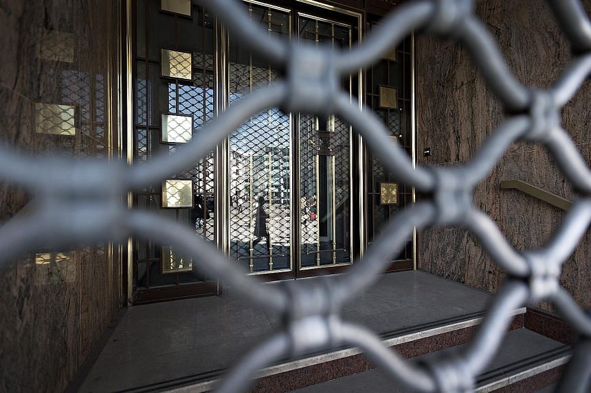 The locked entrance of Lloyds Banking Group's former offices is a reminder that some of the biggest names in global finance have quit Geneva.
