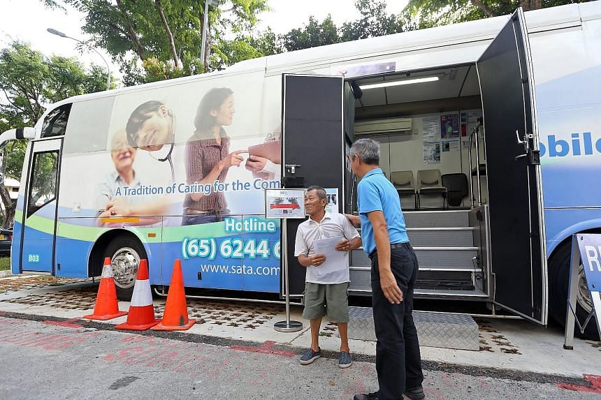 Ang Mo Kio Block 203 resident Ng Kim Beng, 67, was one of those who underwent the tuberculosis screening yesterday, which included a blood test at the block's void deck (left) and an X-ray in a medical services bus (below). Results from the tests and