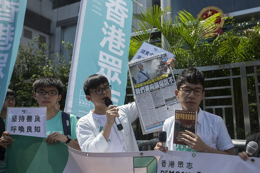 Oscar Lai, vice-chairperson of the Demosisto political party, speaks during a protest against the detention of Lam Wing-kee outside China's Central Government's Liaison Office in Hong Kong on June 17.
