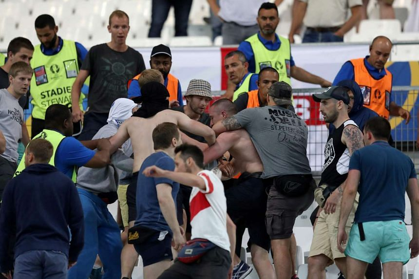 Groups of supporters clash fight at the end of the Euro 2016 group B football match between England and Russia at the Stade Velodrome in Marseille on June 11.