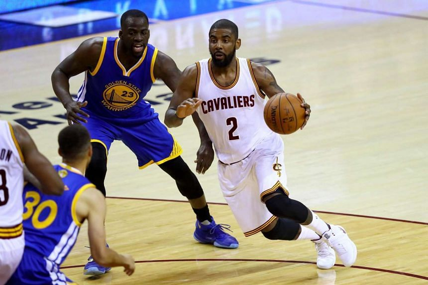 Kyrie Irving (right) of the Cleveland Cavaliers in action against Draymond Green of the Golden State Warriors.