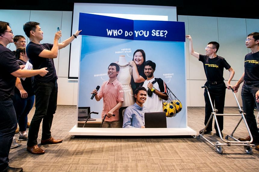 MSF Minister Tan Chuan-Jin (left, holding the banner) at the launch of a disability awareness campaign organised by NCSS and the Tote Board at Enabling Village on June 2.