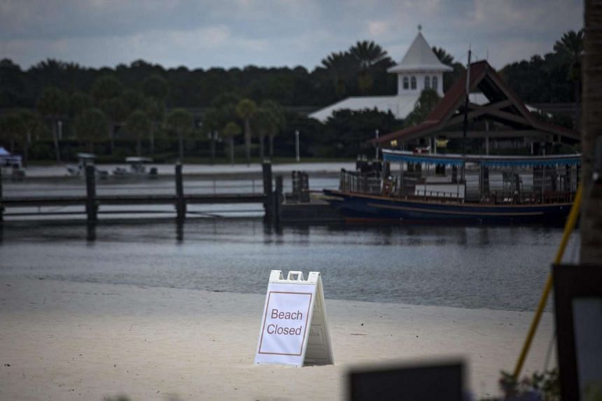 A beach closed sign near the Grand Floridian Resort & Spa at Walt Disney World Resort in Orlando, Florida.