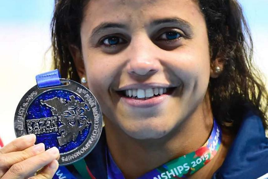 Brazil's Etiene Medeiros poses with her silver medal for the women's 50m backstroke at the 2015 Fina World Championships.