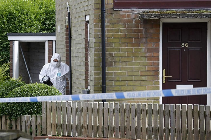 A police forensics officer walks outside the home of a man who was arrested after Labour MP Jo Cox was attacked in her constituency near Leeds, on June 16.