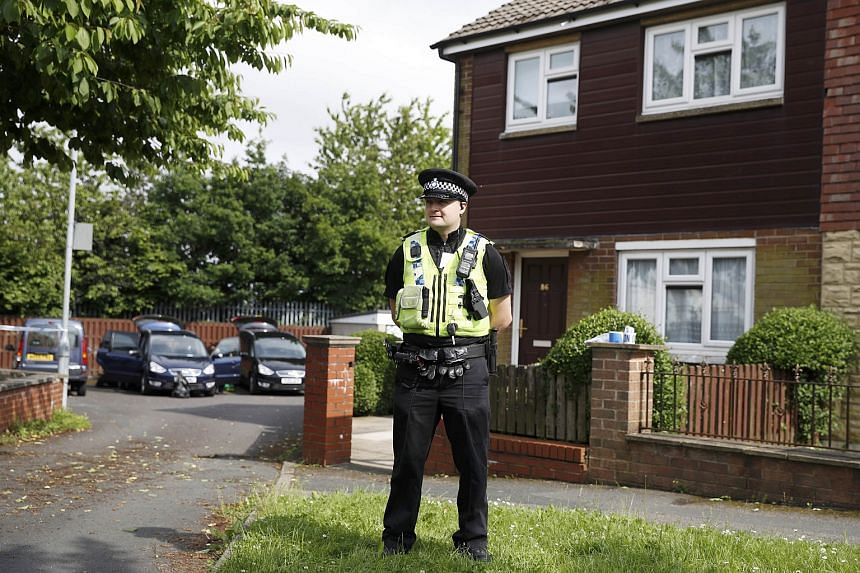 A police officer stands outside the home of a man who was arrested after Labour MP Jo Cox was attacked in her constituency near Leeds, on June 16.