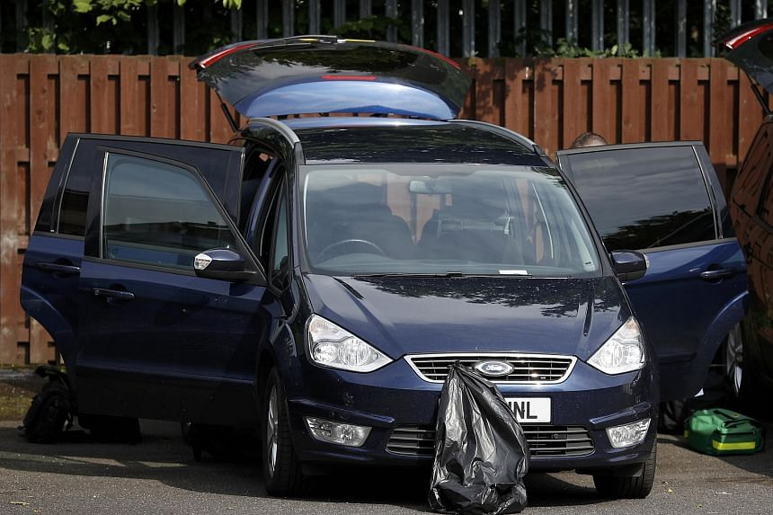 Police search a vehicle outside the home of a man who was arrested after Labour MP Jo Cox was attacked in her constituency near Leeds, on June 16.
