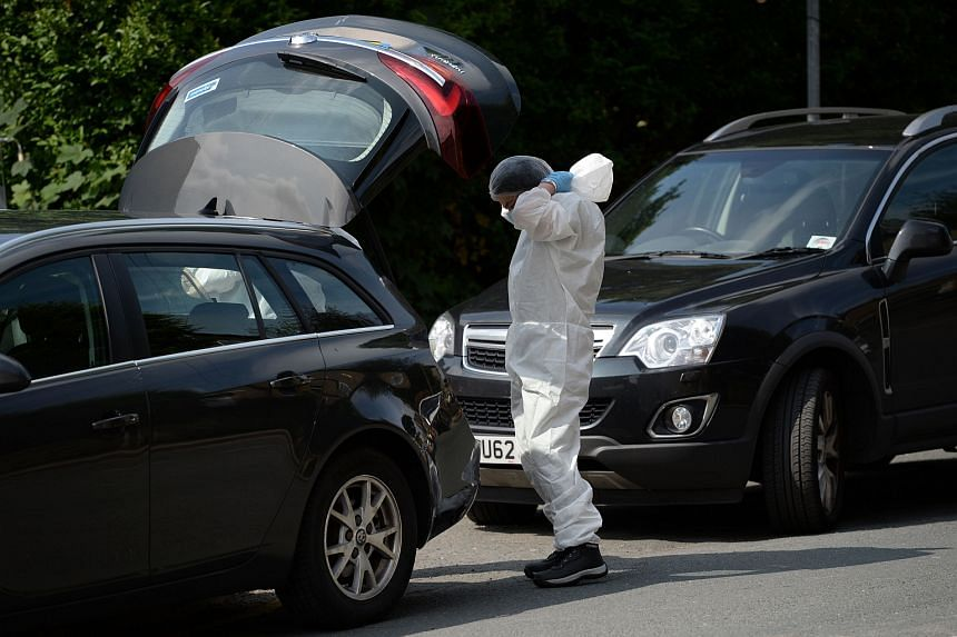 A police forensic officer prepares to work at the scene in Birstall where Labour MP Jo Cox was shot on June 16.