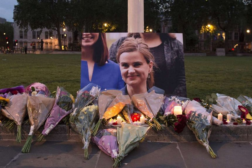 Floral tributes left in memory of British MP Jo Cox in Parliament Square, London, Britain, on June 16.