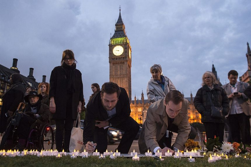 Members of the public sign a memorial to British MP Jo Cox in Parliament Square, London, Britain, on June 16.
