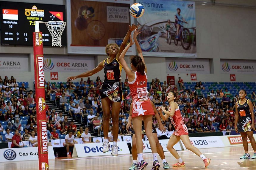 The opening match of the Mission Food Nations Cup 2015 Netball tournament between Singapore and Papua New Guinea on Dec 13, 2015.