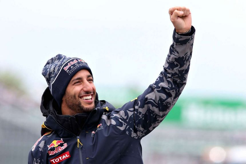 Daniel Ricciardo waves to the crowd on the drivers parade at the Canadian Formula One Grand Prix on June 12, 2016, in Montreal, Canada.