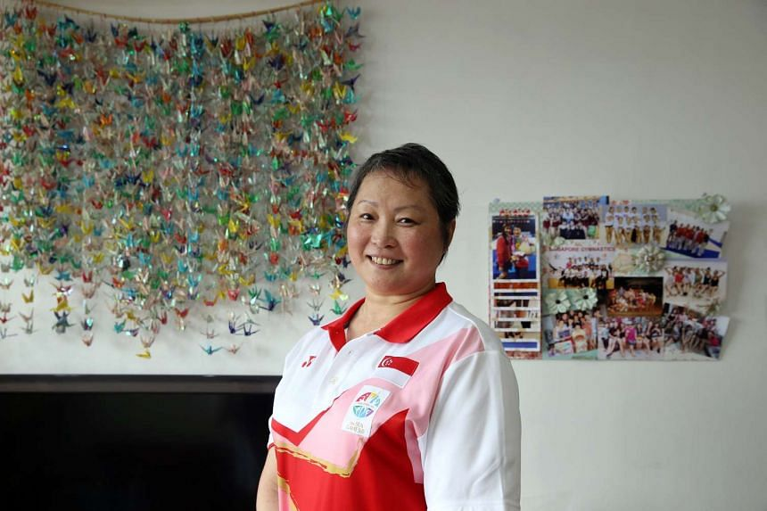 Even as she grew weak from cancer, coach Zhu Xiaoping managed to guide Singapore's gymnastics team to a first gold in last year's SEA Games group all-around competition.