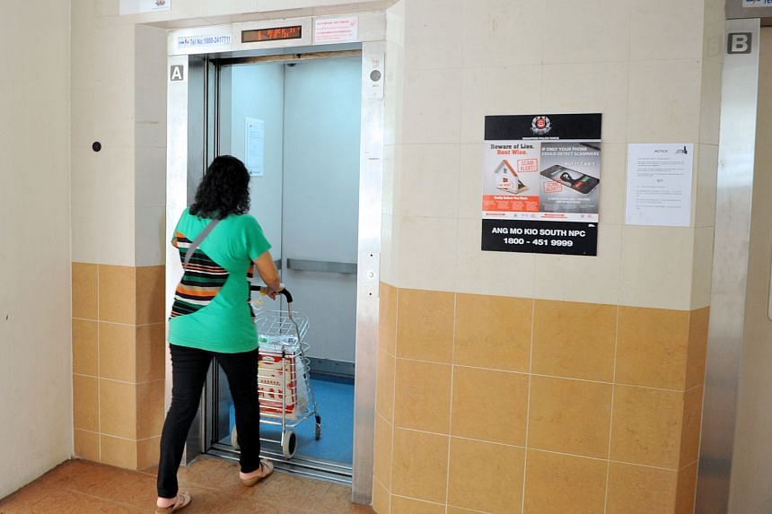 A woman entering a lift at Block 317 in Ang Mo Kio Street 31 on March 29.