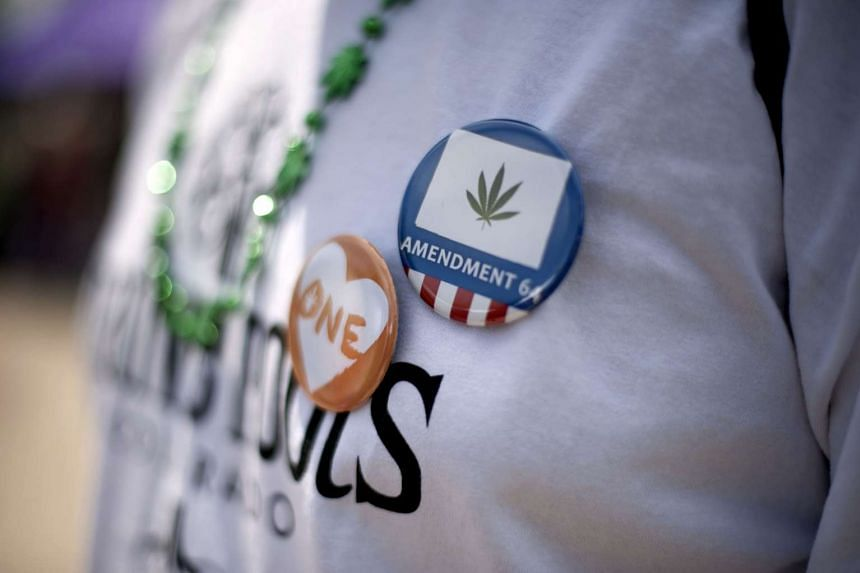 Pro-marijuana buttons worn during a celebration of the legalisation of cannabis and cannabis culture in Denver, Coloroado, on May 21.