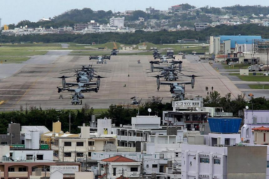 A file picture dated May 19, 2015, shows US Marine Corps MV-22 Osprey aircrafts sitting on the tarmac at US Marine Corps Air Station Futenma in Ginowan on Okinawa Island, southwestern Japan.