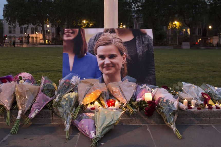 Floral tributes left in memory of British MP Jo Cox in Parliament Square, London, Britain, June 16, 2016.