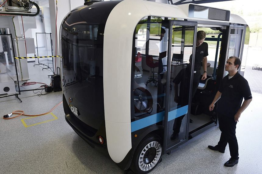 """The 3D-printed minibus called """"Olli"""", capable of carrying 12 people, was unveiled by Arizona-based start-up Local Motors."""