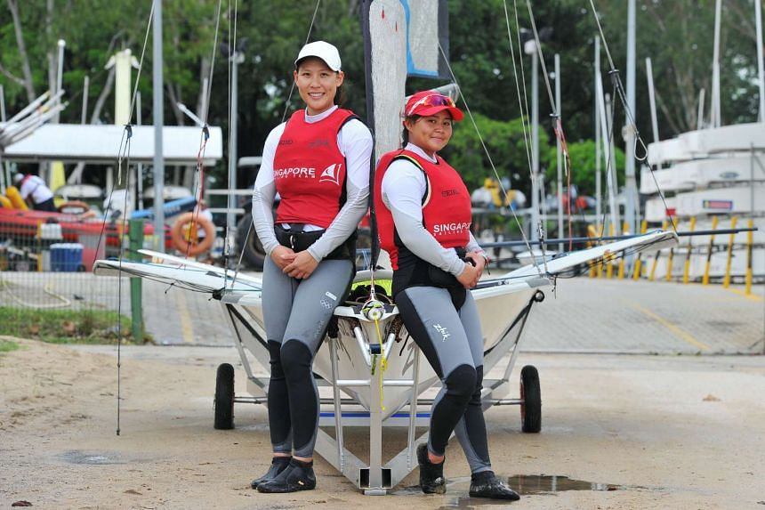 49erFX sailors Sara Tan (left) and Griselda Khng find maintaining their weight a challenge, as they burn about 1,300 calories during each training session.