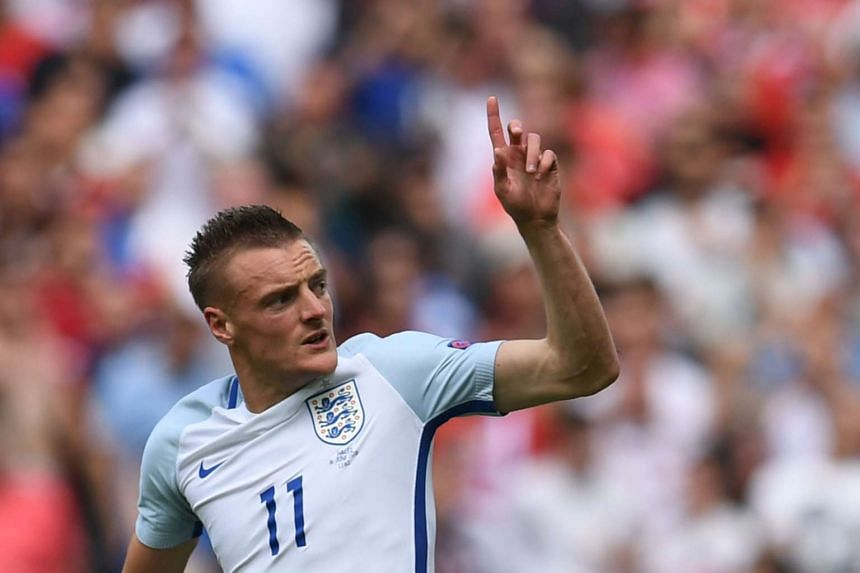 England's forward Jamie Vardy celebrates after scoring the team's first goal.