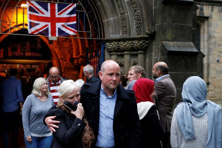 People leave St Peter's Church after a vigil in memory of MP Jo Cox, in Birstall, near Leeds, June 16, 2016