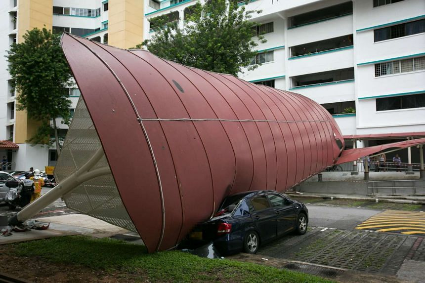A parked car was crushed underneath the collapsed shelter at Block 118, Bukit Batok West Avenue 6.