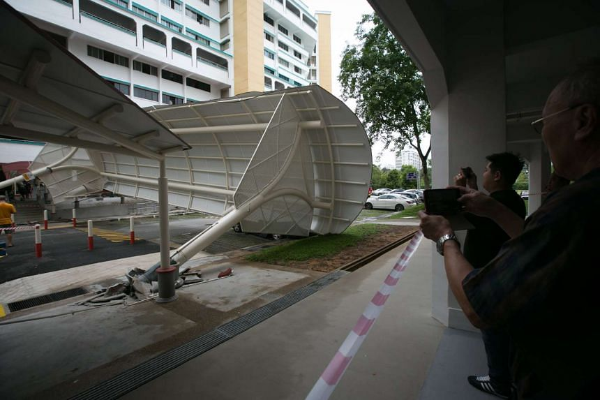 Onlookers taking photos of the collapsed shelter.