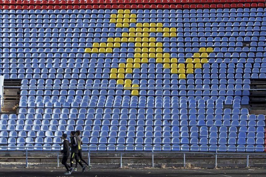 Sportsmen train at a local stadium in the southern city of Stavropol, Russia, in this Nov 10, 2015 file photo.