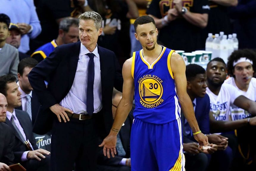 Steve Kerr of the Golden State Warriors and Stephen Curry react in the second half against the Cleveland Cavaliers in Game 6 of the 2016 NBA Finals at Quicken Loans Arena on June 16, 2016 in Cleveland, Ohio.