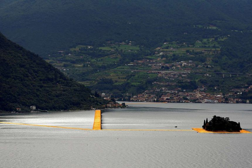 A general view of the installation 'The Floating Piers' by Bulgarian-born artist Christo Vladimirov Yavachev known as Christo, on the Lake Iseo, northern Italy, June 16, 2016.