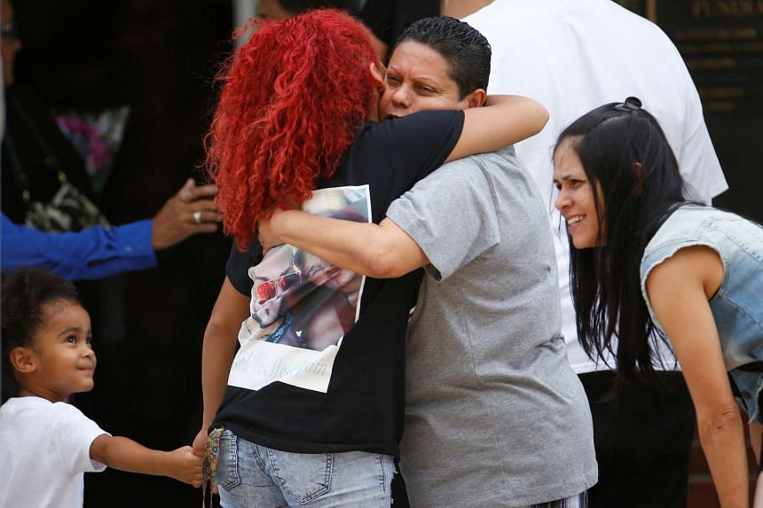 People hug as they arrive for the funeral of Peter Gonzalez-Cruz and Gilberto Ramon Silva Menendez, both victims of the shooting at Pulse night club in Orlando, Florida, US, on June 17, 2016.