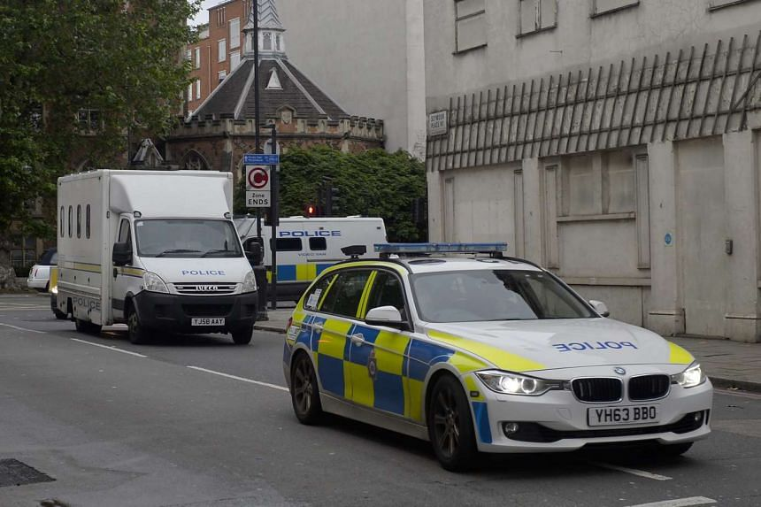 A convoy of police vehicles believed to be transporting Tommy Mair arrives at Westminster Magistrates Court in London on Saturday, June 18, 2016.