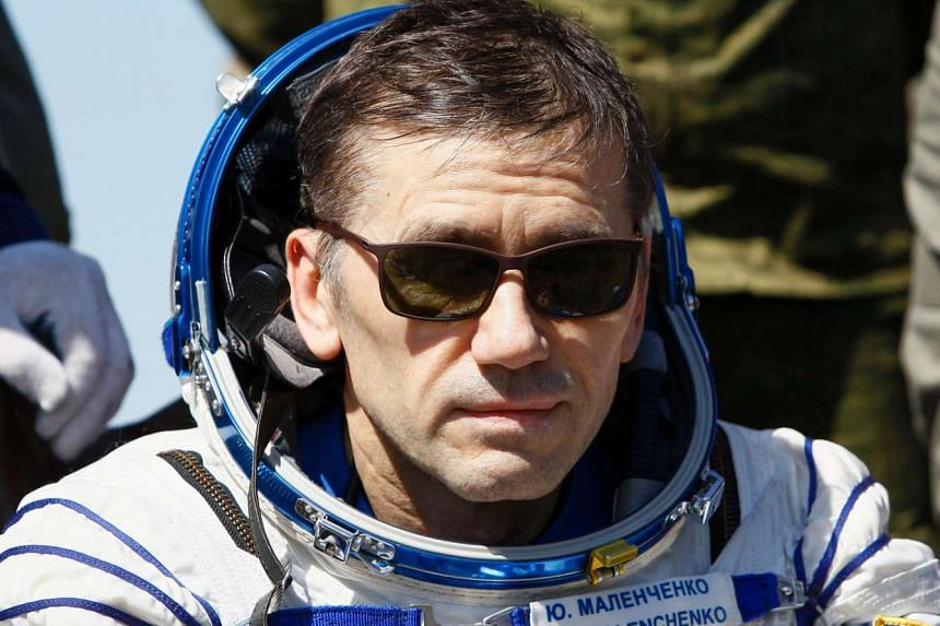 Russian astronaut Yuri Malenchenko resting shortly after landing. REUTERS