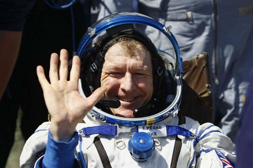 British astronaut Tim Peake waving after a safe landing in Kazakhstan.