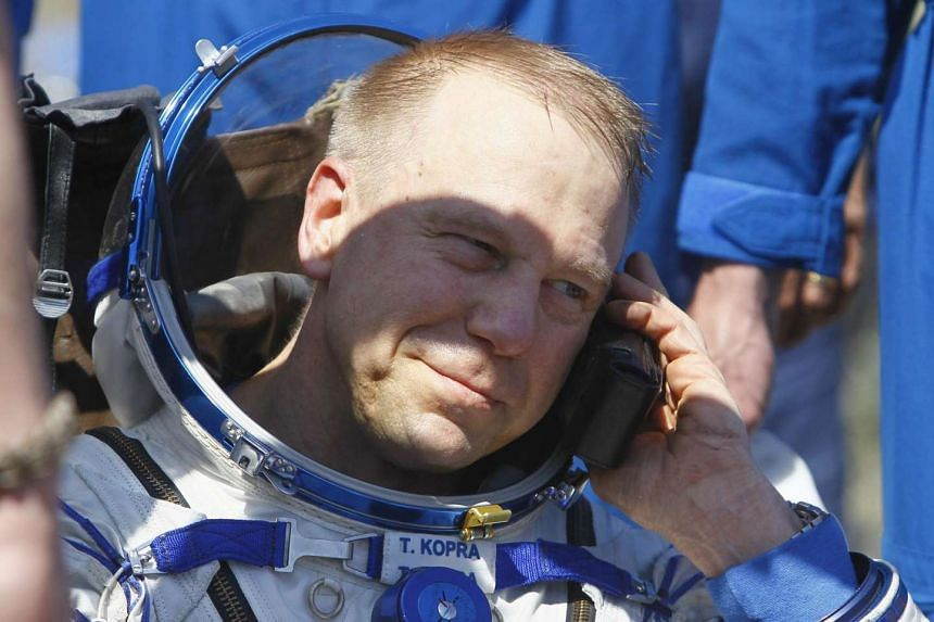 US astronaut Timothy Kopra speaking on a satellite phone shortly after landing.