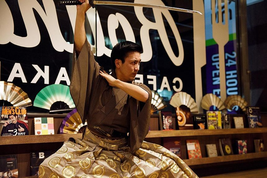 "Mr Arai (above), is determined to spread awareness of his family's form of kenbu sword dancing through ""taiken"" or ""experience"" tours. Traditional activities like sword-making (left) and sumo have recently been incorporated into specially tailored to"