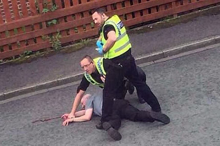 Mair (above) was arrested by police (left) shortly after his attack on Mrs Cox.
